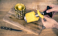 The pineapple corer slicer at work Stock Image