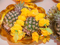 Pineapple with flowers was prepare for kanesha pray in thailand temple Royalty Free Stock Photo