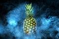 Pineapple fruit on background with vape smoke