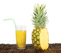 Pineapple and glass of juice studio shot Royalty Free Stock Image