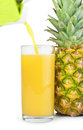 Pineapple and glass of juice studio shot Royalty Free Stock Images