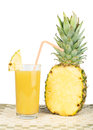 Pineapple and glass of juice studio shot Royalty Free Stock Photo