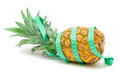 Pineapple and measuring tape on a white background Royalty Free Stock Photo