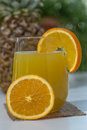 Pineapple orange juice single glass of two oranges on glass with in background Stock Photos