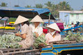 Pineapple preparation at floating market vinh long vietnam february three women wearing conical hats sit on a boat preparing Royalty Free Stock Photography