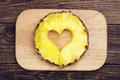 Pineapple slices with a cut in the shape of hearts on a cutting board Royalty Free Stock Photography