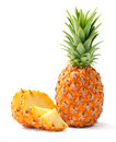 Pineapple and slices on white background Stock Photos