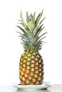 Pineapple stands on a table.