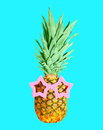 Pineapple with sunglasses on blue background, ananas Royalty Free Stock Photo