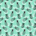 Pineapples seamless pattern on mint background