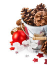 Pinecone in bucket with christmas tinsel on white background Royalty Free Stock Photos