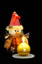 Pinecone snowman and gold candle. Royalty Free Stock Photo
