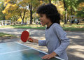 Ping pong cute little boy plays in the park Stock Image