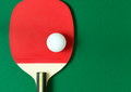 Ping pong paddle with ball Royalty Free Stock Photo
