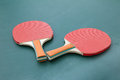 Ping pong paddles on a board red table tennis two green Stock Photo