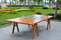 Ping pong table solid wood sitting outside in a beach resort Royalty Free Stock Photo
