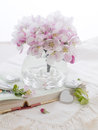 Pink apple blossom in glass vase for celebration selective focus Royalty Free Stock Photo