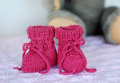 Pink baby booties Stock Photos
