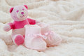 Pink baby booties shoes and a teddy bear soft plush blanket and ready for a new girl Royalty Free Stock Image