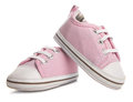 Pink baby sneakers on white background Stock Photos