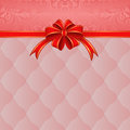Pink background with red ribbon for gifts Stock Photography