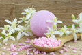 Pink bath bomb and bath salt on a spoon on a wooden background Stock Images