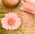pink bath salt, pink gerber and towel Royalty Free Stock Photo