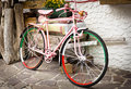 Pink bicycle of tour of italy painted in for the Royalty Free Stock Photo