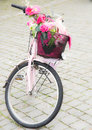 Pink bike wiht flower deco in the bakset Royalty Free Stock Photo