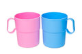 Pink and blue plastic cup isolated on white background Royalty Free Stock Photos