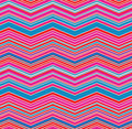 Pink blue red chevron zig zag seamless pattern design in and greyish white suitable for use in carnival funfair events Royalty Free Stock Photos