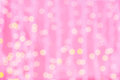 Pink blurred background with bokeh lights holidays party and celebration concept and golden Stock Images