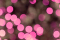 Pink blurred lights defocused image with on christmas tree Stock Images