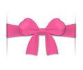 Pink bow inserted into cuts in a background Stock Image