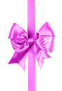 Pink bow made from silk ribbon isolated Stock Photo