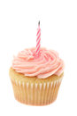 Pink buttercream iced cupcake with a single birthday candle Royalty Free Stock Photo