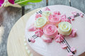 Pink cake on the wooden table Royalty Free Stock Photo