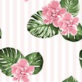 Pink camelia flowers green monstera leaves on vertical stripes background. Exotic tropical floral seamless pattern.
