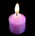 Pink candle into a darkness Royalty Free Stock Photo