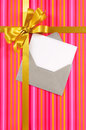 Pink candy stripe Christmas or birthday card with gold gift ribbon and bow and blank card with envelope Royalty Free Stock Photo