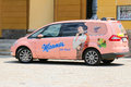 """A pink car with sticker manner on tour in innsbruck austria """"manner tour"""" parking july is wafers manufacturer it's Royalty Free Stock Photo"""
