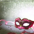 Pink carnival mask with glittering background Stock Images
