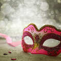 Pink carnival mask with glittering background Royalty Free Stock Photos