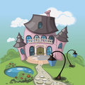 Pink castle with a pond towers standing in the middle of large park ornamental Stock Images