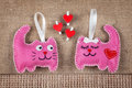Pink cats in love funny from felt with red hearts Royalty Free Stock Photo