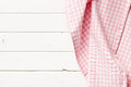 Pink checkered napkin top view of on white wooden table Stock Image