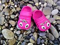 Pink children`s beach rubber slippers Royalty Free Stock Photo