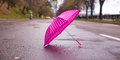Pink children s umbrella on the wet asphalt outdoors see my other works in portfolio Stock Image