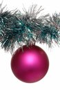 Pink christmas tree decoration and shining tinsel Royalty Free Stock Photo
