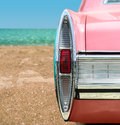 Pink classic car vintage on the beach Stock Images